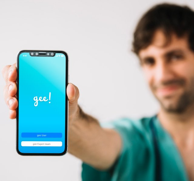 The doctor is showing the app of gee